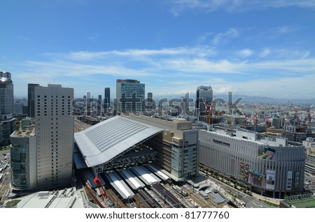 OSAKA, JAPAN - JULY 9: The newly rebuilt Osaka Station in Umeda is the busiest transit hub in Western Japan and hosts upscale shops and fine dining establishments July 9, 2011 in Osaka, Japan. - stock photo