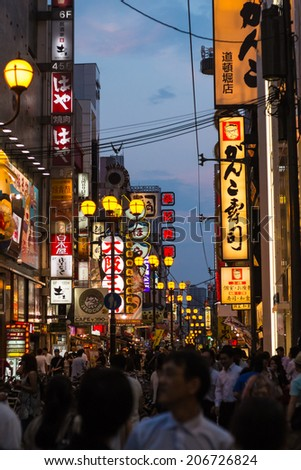 OSAKA,JAPAN- JULY 22: Twilight view of the neon advertisements Dotonbori on Jul 22, 2013 in Osaka, Japan.Is famous for its historic theatres,and restaurants, and its many neon and mechanised signs