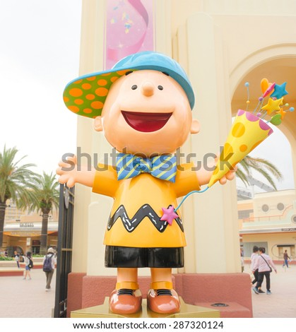 OSAKA, JAPAN - JUN 2, 2015 : Photo of Charlie Brown figure standing in the front gate on Universal Studio, Osaka, Japan in welcoming visitors gesture. - stock photo