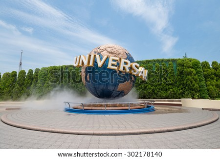 Osaka, Japan - JUN 9: Universal Globe outside the Universal Studios Theme Park in Osaka, Japan on Jun 9, 2015. The theme park has many attractions based on the film industry. - stock photo