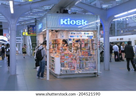 OSAKA JAPAN - 3 JUNE, 2014: Unidentified people shop at Kiosk at JR Osaka Train station. Osaka station is the major railway station in the Umeda district.  - stock photo