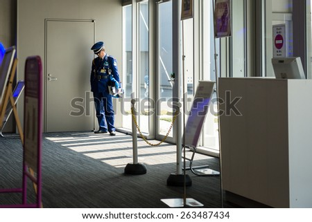 OSAKA, JAPAN - MARCH 14, 2015: Airport Police standing alone at Kansai International Airport terminal.  - stock photo