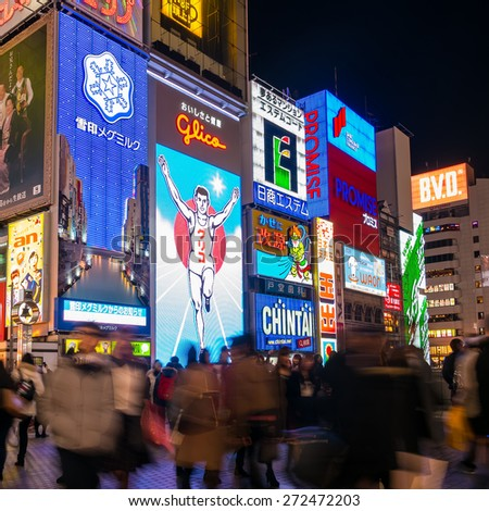 Osaka, Japan- March 2, 2015 : Unidentify tourists take a photo with the Glico Man, light billboard in Dotonbori shopping street in Osaka, Japan