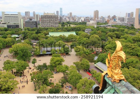 Osaka, Japan - May 28, 2013: Beautiful Scenery of Osaka with the statue of Shachihoko, the mythical creature with a dragon head and a fish body, on the tower roof ridge of Osaka Castle. - stock photo
