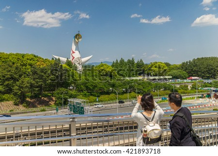 OSAKA, JAPAN - 05 May 2016 - Tower of the Sun or Taiyo no To was created by Japanese artist Taro Okamoto. The symbol of Expo '70 and currently is located in the Expo Commemoration Park. - stock photo