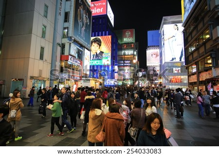 OSAKA, JAPAN, NOV 23:Dotonbori neon boards with the busy street in Osaka on 23 november 2014. Dotonbori is one of the principal tourist destinations in Osaka, Japan