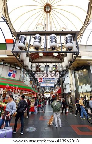 OSAKA, JAPAN - NOV 6: Tourists shopping and visit  in Kuromon Ichiba market on November 6, 2015 in Osaka, Japan. it is market places popular of Osaka - stock photo