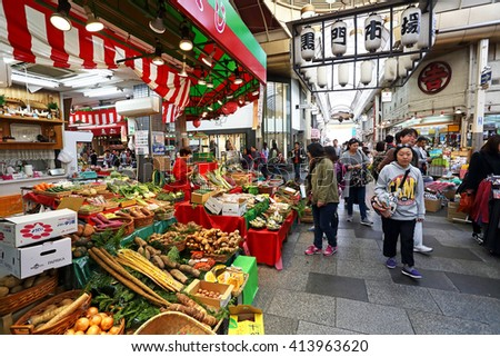OSAKA, JAPAN - NOV 6: Tourists shopping and visit vegetables and fruits prices in shop  in Kuromon Ichiba market on November 6, 2015 in Osaka, Japan. it is market places popular in Osaka