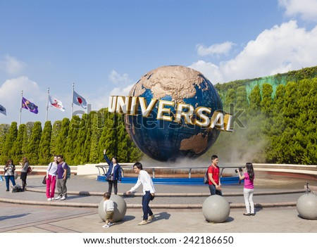 Osaka, Japan - Oct 27: View of tourists and Universal Globe outside the Universal Studios Theme Park in Osaka, Japan on Oct 27, 2014.  The theme park has many attractions based on the film industry. - stock photo