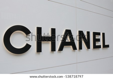 OSAKA JAPAN - OCTOBER 18, 2016: Chanel fashion brand logo. Chanel is a French privately held company that specializes in ready-to-wear clothes, luxury goods and fashion accessories