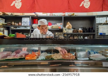 OSAKA, JAPAN - OCTOBER 24: Endo Sushi in Osaka, Japan on October 24, 2014. Unidentified Japanese Sushi chef prepares food for his customer at Endo Sushi, the restaurant that runs more than 100 years.