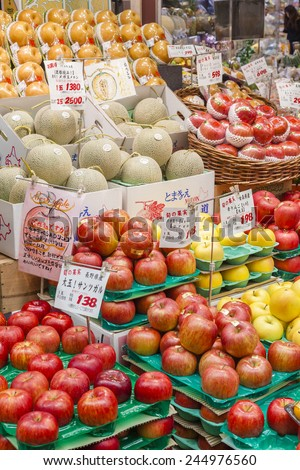 Osaka, Japan - October 26, 2014: Fresh fruits in a greengrocery in Kuromon Market in Osaka, Japan. The Kuromon Market has been called 'Osaka's Kitchen' since it opened as many cooks in Osaka come here