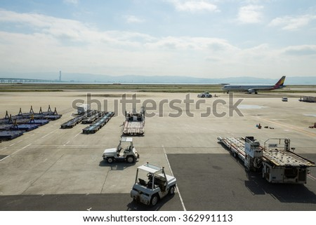 OSAKA, JAPAN - OCTOBER 6, 2015: Luggage transportation vehicles at Kansai International Airport.