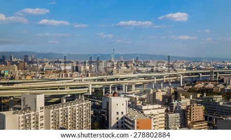 OSAKA, JAPAN - OCTOBER 28: Osaka Bay in Osaka, Japan on October 28, 2014. Industries locate around Osaka Bay because there are skilled and plentiful workforce, many port facilities, efficient linkages - stock photo