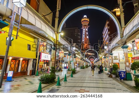 OSAKA, JAPAN - OCTOBER 24: Tsutenkaku Tower in Osaka, Japan on October 24, 2014. Renowned landmark of Osaka, this second generation of  tower was built after the WWII in 1956 in it's original site - stock photo