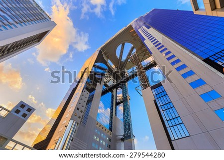 OSAKA, JAPAN - OCTOBER 27: Umeda Sky Bldg. in Osaka, Japan on October 27, 2014.A pair of skyscrapers connected in midair in an unusual architectural form, one of the city's most recognizable landmarks - stock photo