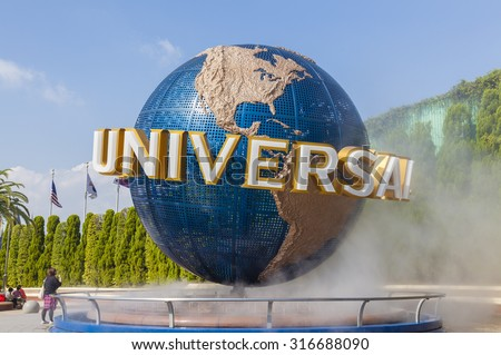 Osaka, Japan - October 27, 2014: View of tourists and Universal Globe outside the Universal Studios Theme Park in Osaka, Japan. The theme park has many attractions based on the film industry. - stock photo
