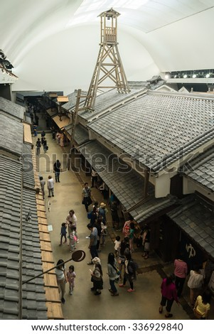 OSAKA, JAPAN - SEPTEMBER 22, 2015: Life-sized reproduction of the Edo-period town in Osaka Museum of Housing and Living. - stock photo