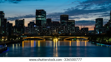 OSAKA, JAPAN - SEPTEMBER 21, 2015: Night view of Nakanoshima and Tenjinbashi bridge seen from Temmabashi, Osaka.