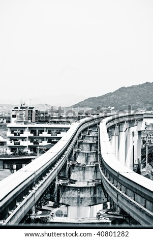 Osaka monorail track. Monochrome toned - stock photo