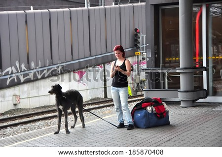 OSLO - AUGUST 16:Unidentified female waiting for a train at the Oslo Railway Central Station on August 16, 2012 in Oslo, Norway.