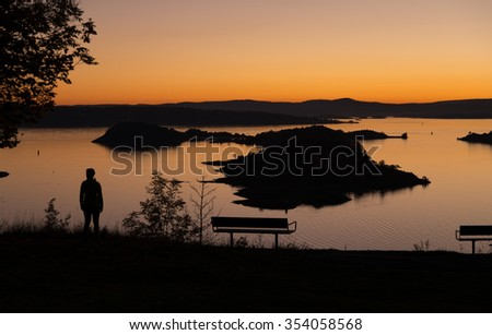 Oslo fjord islands sunset view from Ekeberg - stock photo