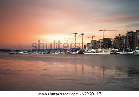 Oslo harbor in the beautifull sunrise. Norway - stock photo