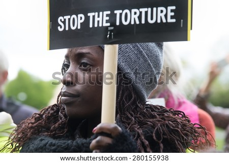 OSLO - MAY 19: Human rights activists protest at the Saudi Arabian embassy in Oslo, Norway, to demand the release of imprisoned Saudi blogger Raif Badawi, May 19, 2015.  - stock photo