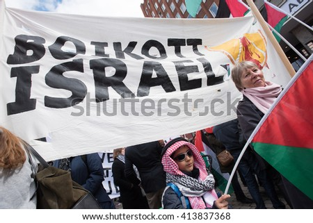 OSLO - MAY 1: Solidarity activists carry  banners calling for a boycott of Israel during the May Day parade in Oslo, Norway, May 1, 2016. - stock photo