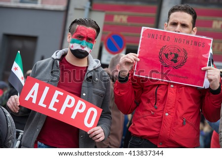 OSLO - MAY 1: Syrian refugees protest violence in Aleppo  and UN ineffectiveness during the May Day parade in Oslo, Norway, May 1, 2016. - stock photo
