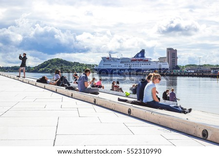 OSLO, NORWAY   AUG 10, 2016. People Sitting Having Rest And Looking On