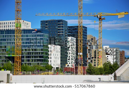 OSLO, NORWAY AUGUST 17, 2016: A construction site of Bjorvika under construction in progress with a heavy vehicle and cranes in Oslo, Norway on August 17,2016.