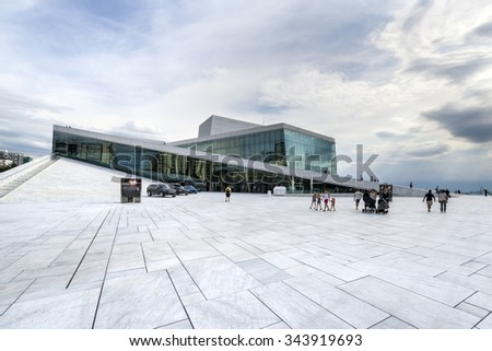 OSLO, NORWAY - AUGUST 24, 2015: The Oslo Opera House in Norway.  The angled exterior surfaces of the building are covered with white granite and make it appear to rise from the water.