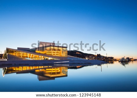 OSLO, NORWAY - JANUARY 1: National Oslo Opera House shines at sunrise on January 1, 2013. Oslo Opera House was opened on April 12, 2008 in Oslo, Norway - stock photo