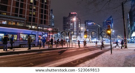OSLO, NORWAY - JANUARY 7, 2016 : Pedestrian crowd in downtown city night in Oslo, Norway on January 7, 2016.