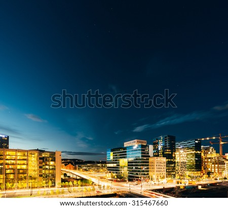 OSLO, NORWAY - JULY 31, 2014: Night view of street in the city centers in Oslo, Norway. Summer evening. Twilight, day to night. Construction of skyscrapers.