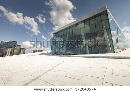 OSLO, NORWAY - JULY 09: View on a side of the National Oslo Opera House on July 09, 2014 in Oslo, Norway  - stock photo