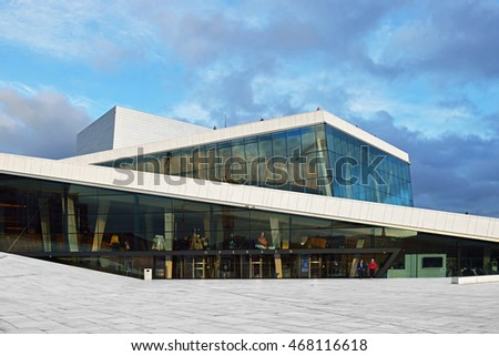 OSLO, NORWAY - JUNE 11, 2016: Oslo Opera House is home of Norwegian National Opera and Ballet, and national theatre in Norway. Sunset
