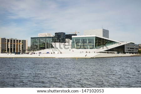 OSLO, NORWAY - JUNE 15: Oslo Opera house is the home of the Norwegian National Opera and Ballet incorporating a large pedestrian plaza with extensive panoramic views on June 15, 2013 in Oslo, Norway