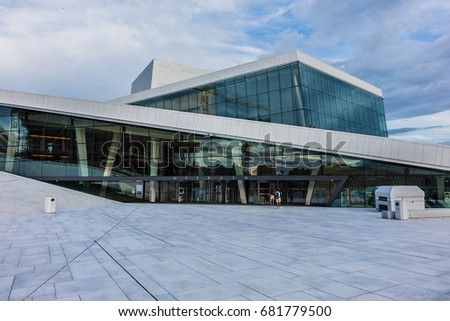 OSLO, NORWAY - JUNE 14, 2017: The Oslo Opera House (Operahuset, architect Snohetta, 2008) - home of Norwegian National Opera and Ballet. Building is situated in Bjorvika neighborhood of central Oslo.