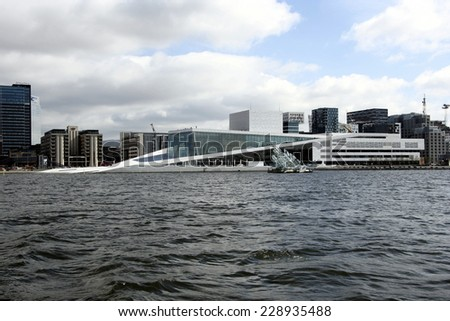 OSLO, NORWAY-10 MAY 2013 - National Opera House in Oslo, Norway. The only opera house in the world where the public are allowed total access to walk on the roof of the structure. - stock photo