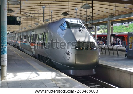 OSLO, NORWAY -30 MAY 2015- The Flytoget Airport Express Train is a Norwegian high speed rail connecting the Oslo Airport Gardermoen (OSL) to Oslo Central Station in nineteen minutes.