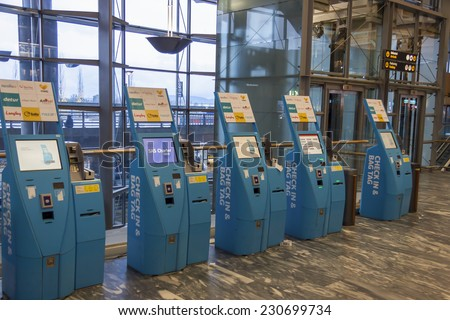 OSLO, NORWAY - November 27, 2014: Lots of machines to check passenger hall at Oslo Airport Gardermoen - stock photo
