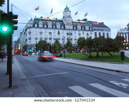 OSLO, NORWAY-SEPT. 12: The historic Grand Hotel is seen with Norwegian national flags blowing in wind in Oslo, Norway on September 12, 2016.