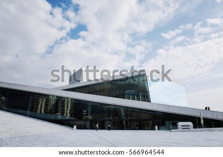 Oslo, NORWAY - SEPTEMBER 8, 2014: Oslo Opera House. Oslo's Opera House is located right at the harbour, with an angled, white exterior that appears to rise from the water.