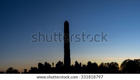 Oslo, Norway. Vigeland park at sunset with silhouette of people and sculptures. Taken on 2015/10/25