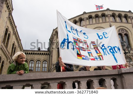"OSLO - SEPTEMBER 12: Norwegian rallying in support of Syrian refugees hold a banner reading, ""Let's Be Human"", Oslo, Norway, September 12, 2015."