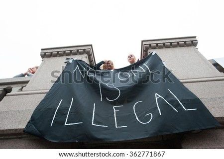 "OSLO - SEPTEMBER 12: Norwegians rallying in support of Syrian refugees hold a banner reading, ""No One Is Illegal"", in front of the parliament building in Oslo, Norway, September 12, 2015."