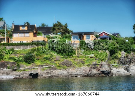 Oslofjord. Beautiful summer colors and vegetation of the famous Fjord of Oslo. - stock photo