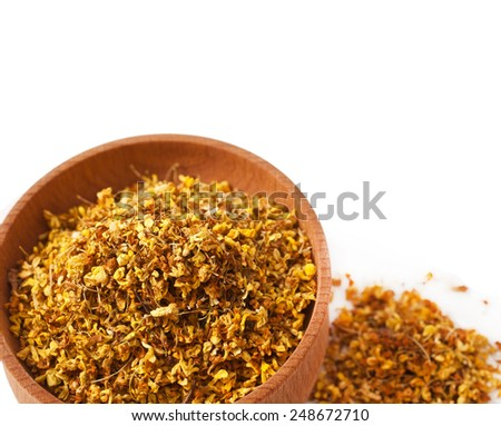"""Osmanthus """"Fragrant Flower"""" Tea in the wooden bowl isolated on white background  - stock photo"""